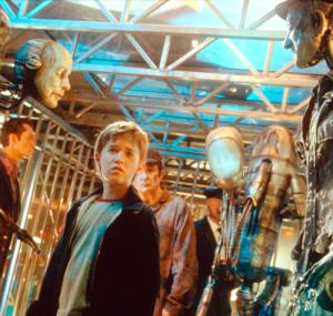 Haley Joel Osment and Jude Law in the film AI