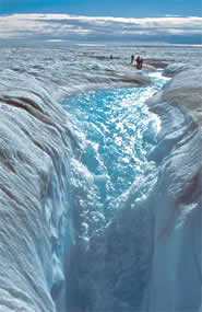 Meltwater stream flowing into a large moulin in the Greenland ice sheet (Credit: Roger Braithwaite, University of Manchester)