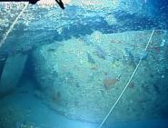 The sunken turret now lies upside down beneath the ship's hull (Photo: NOAA)