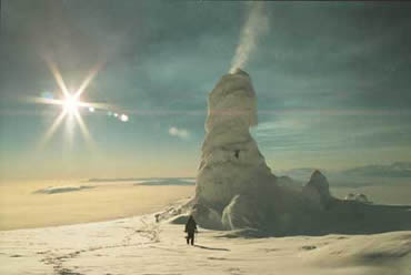 An ice tower on Mount Erebus looms over an expeditioner