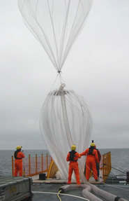 The launch crew test inflating the balloon aboard the Triton