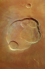The concentric depressions in the caldera reveal several successive eruptions