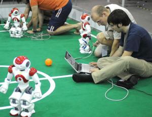 Technicians test the robots before a robot football match during the 2008 Robot World Cup Soccer Games (Robocup)