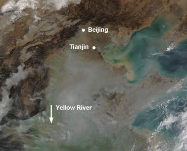 Image 1: Haze from industrial and human activity in eastern China pools in the Yellow River's coastal plain