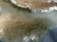 Image 2: Haze and dust lap up against the Himalayas in northern India