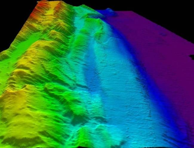 The sonar image reveals ridges 1500 metres tall and a massive trench