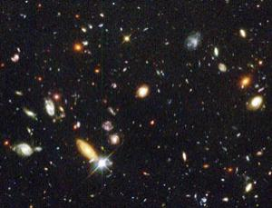 The Hubble Deep Field. These distant galaxies are racing away from us far faster than theory predicts
