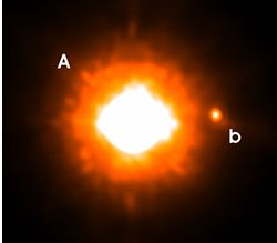 The star GQ Lupi is orbited by planet – labelled b – at a distance approximately 20 times greater than that between Jupiter and the Sun