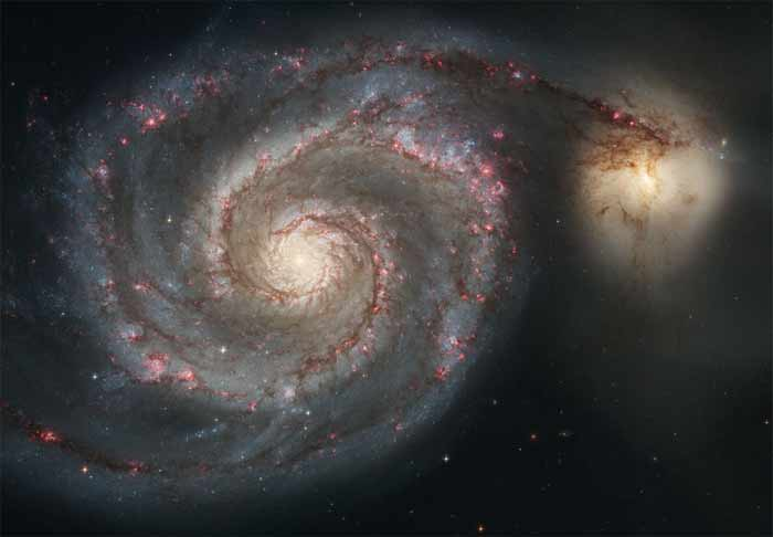 New stars smoulder in the arms of the Whirlpool galaxy