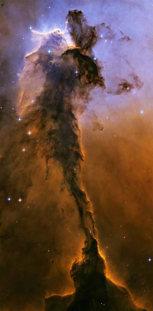 The Eagle Nebula's giant spire of gas and dust is incubating stars