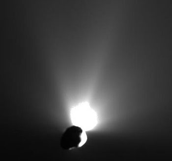 Fifty minutes after impact, Deep Impact's flyby spacecraft looked back to see material still streaming away from comet Tempel 1 – the plume could blaze for weeks