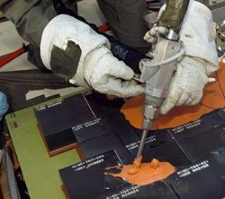 A goo gun for repairing damaged heat-resistant tiles has been tested in aircraft and will fly on Discovery.