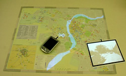 The augmented map system can project video onto a blank surface, or send relevant web links to a handheld computer