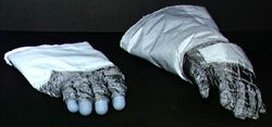 The pressurised inner glove (left) is attached to the spacesuit by pressure-sealed rings in the Apollo glove. The outer glove must protect against micrometeorites, abrasions and heat