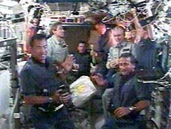 The station crew rang the outpost's bell to welcome Discovery's astronauts, continuing a US Navy tradition