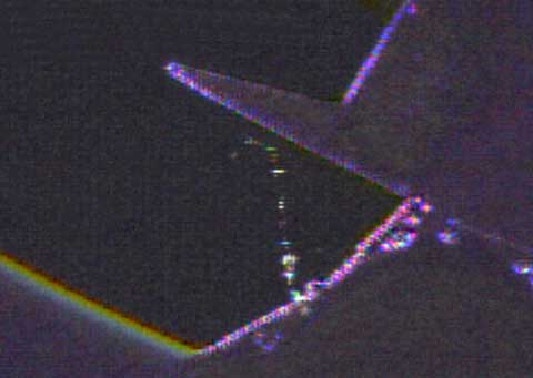 Radar tracking data shows a piece of foam debris changes the direction near the shuttle's wing, indicating it may have hit it