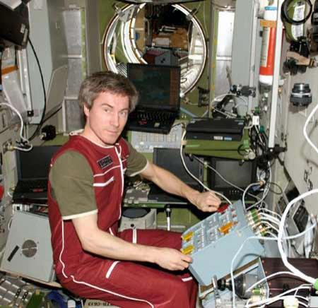 Sergei Krikalev, who has spent over two years in space, tests newly installed hardware in the Zvezda Service Module of the International Space Station