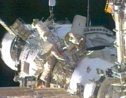 NASA science officer John Phillips and commander Sergei Krikalev work outside the Zvezda Service Module