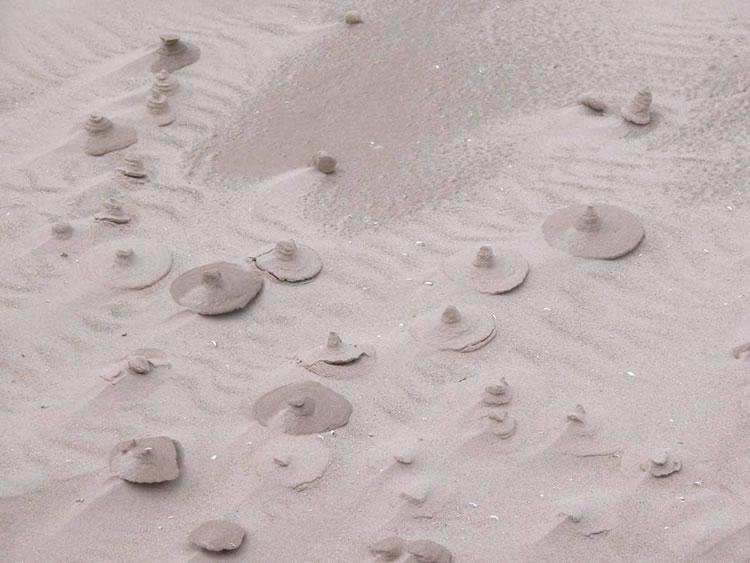 Unusual pointed sand forms on a beach in northern Lake Michigan