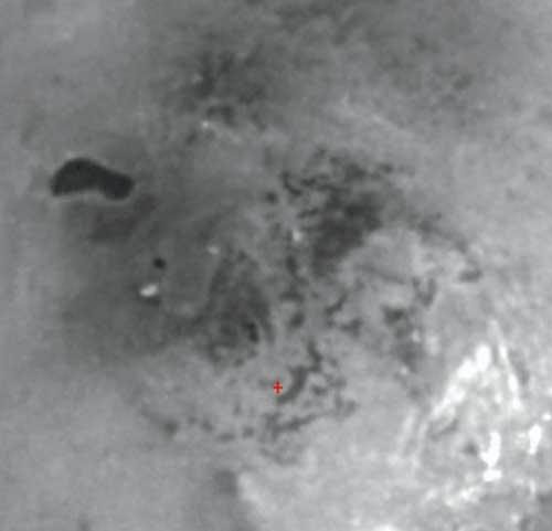Titan's south polar region has an intriguing dark feature that may be the site of a past or present lake of liquid hydrocarbons. Resolution in the scene is 3 kilometres (2 miles) per pixel.