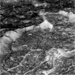 The sharp ice cliffs of Dione, viewed from 5500 kilometres away