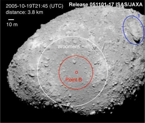 The second sampling will take place on 25 November from a broad, flat region (circled in red) on the asteroid's tip, dubbed the Woomera Desert. A giant boulder is circled in blue