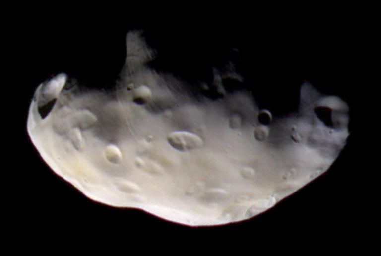 Cassini captured three images of Pandora in infrared, ultraviolet and visible light, which were combined to create the final picture