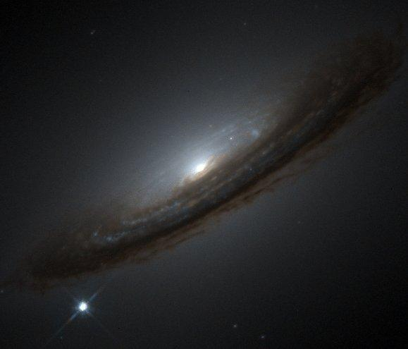 A type Ia supernova (lower left) occurred on the outskirts of galaxy NGC 4526
