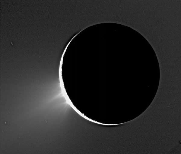 Fountain-like volcanic activity was revealed on the surface of Enceladus in an image backlit by the Sun