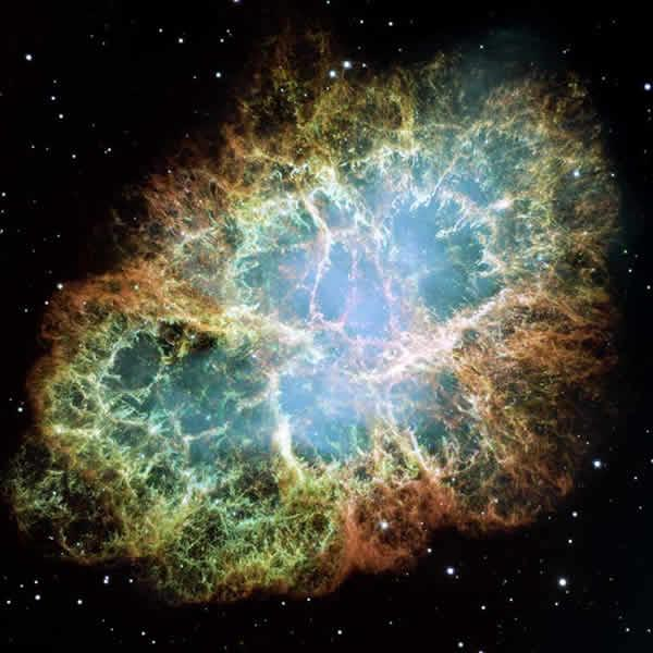 This mosaic image of the 6-light-year-wide Crab Nebula is one of the largest ever taken by Hubble - the orange filaments are the tattered remains of a star that blew up nearly 1000 years ago