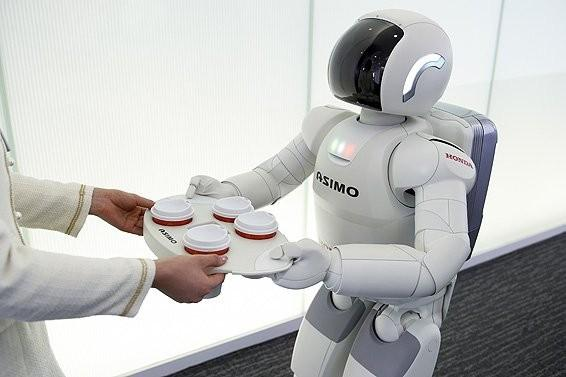 The latest Asimo model serves coffee to visitors