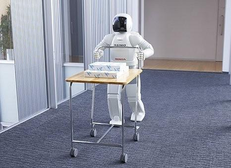 The new Asimo can push a cart carrying up to 10 kilograms
