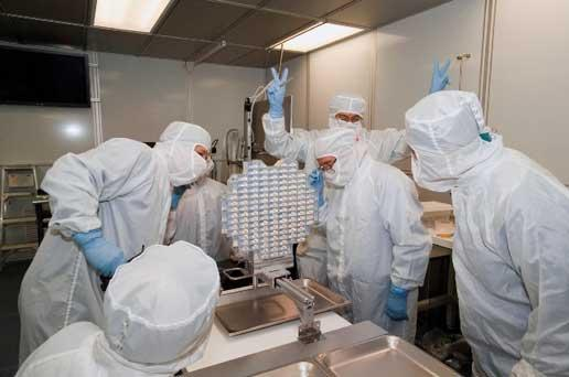 Scientists examine Stardust's Aerogel collector in a clean room at Johnson Space Center in Houston, Texas