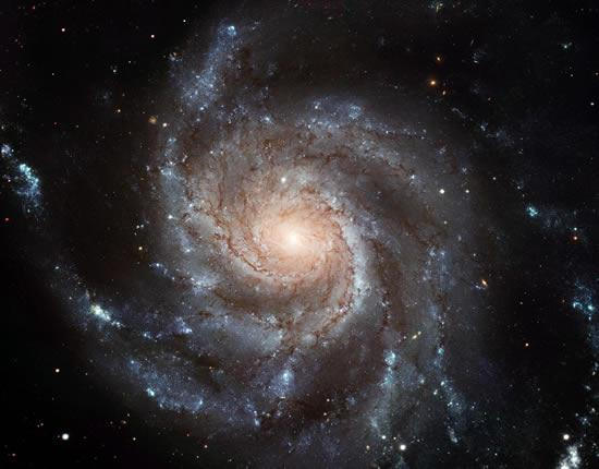 Fifty-one images from the Hubble Space Telescope have been compiled to create this portrait of the Pinwheel Galaxy