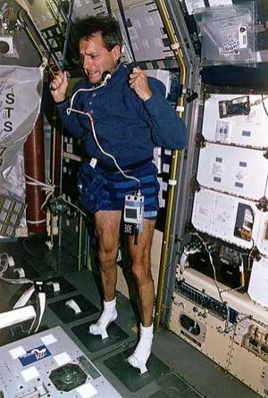 STS-78 Mission Specialist Richard Lirnehan works out during the shuttle Columbia flight in 1996