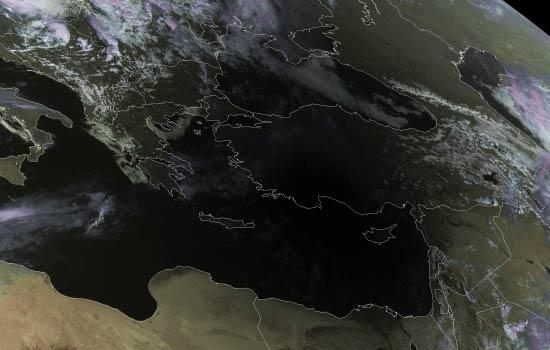 The Moon's shadow is cast over the Sahara Desert in this image taken by the Meteosat Second Generation channel 2, a geostationary meteorological satellite