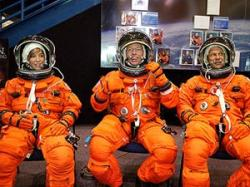 Astronauts Lisa Nowak, Mike Fossum and Piers Sellers are part of Discovery's next crew to launch to the ISS