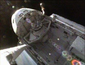 The camera on the shuttle's robotic arm looks back at Discovery's payload bay and crew cabin