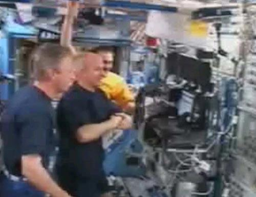The crew of the International Space Station watch the shuttle's return to Earth - Discovery undocked on Saturday