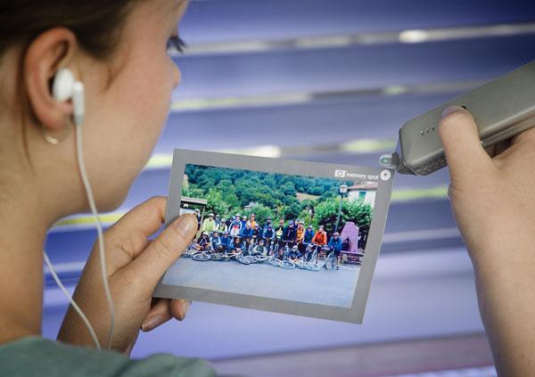 A prototype Memory Spot reader accesses video, music and text from a chip embedded in a photo