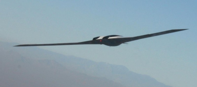 The Polecat UAV is pictured flying at 15,000 feet by a chaseplane. Polecat's airframe was