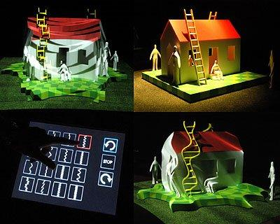 The Morphovision display using light tricks to make a model house seem to contort or even break apart
