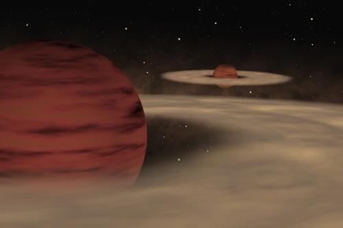 A pair of free-floating planetary mass objects orbit one other, each surrounded by a dusty disc (Artist's impression: ESO)