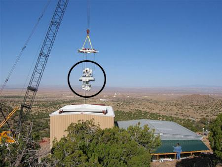 The mirror relay (circled) consists of two 75-centimetre-wide mirrors suspended 30 metres above the ground