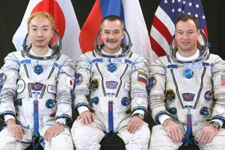Daisuke Enomoto (left) spent months training with cosmonaut Mikhail Tyurin (centre) and astronaut Michael E. Lopez-Alegria for a trip to the space station on a Russian Soyuz