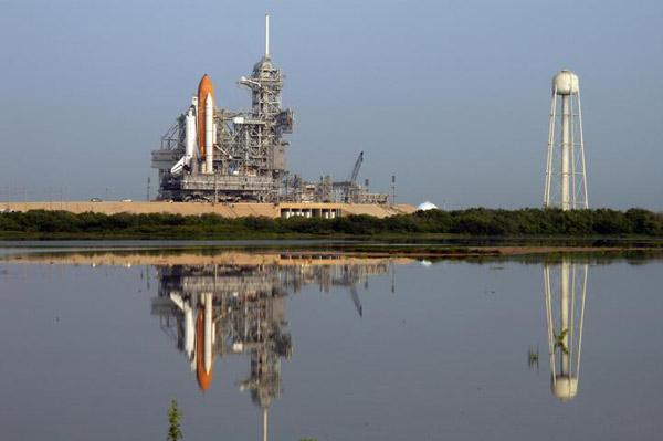Clear skies greeted the shuttle Atlantis when it rolled onto the launch pad on 2 August - now NASA is preparing to bring it back to its protective hangar