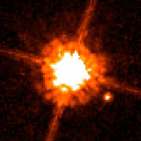 An object as massive as about 12 Jupiters orbits a low-mass star called a red dwarf – the pair is thought to have condensed from a cloud of gas