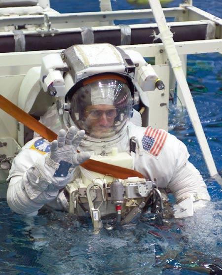 Canadian astronaut Steve MacLean is lowered into the Neutral Buoyancy Laboratory at Johnson Space Center in Texas, US, to practice a spacewalk