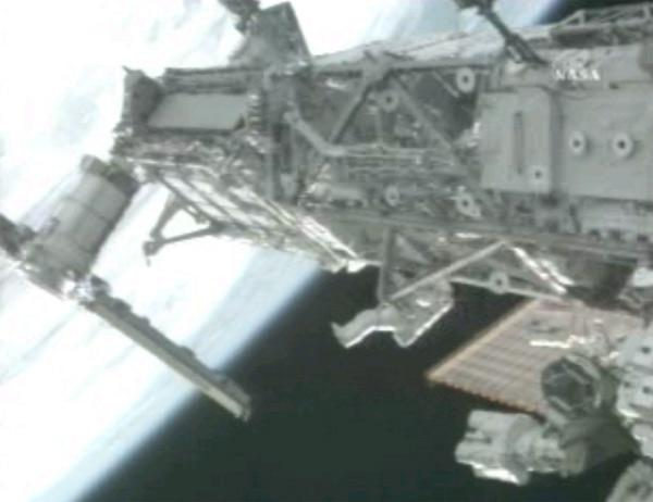 Spacewalker Joe Tanner crawls along the International Space Station's truss during Tuesday's spacewalk