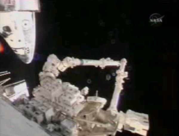 Astronauts Steve MacLean and Jeff Williams moved the station's robotic arm on Thursday from inside the station
